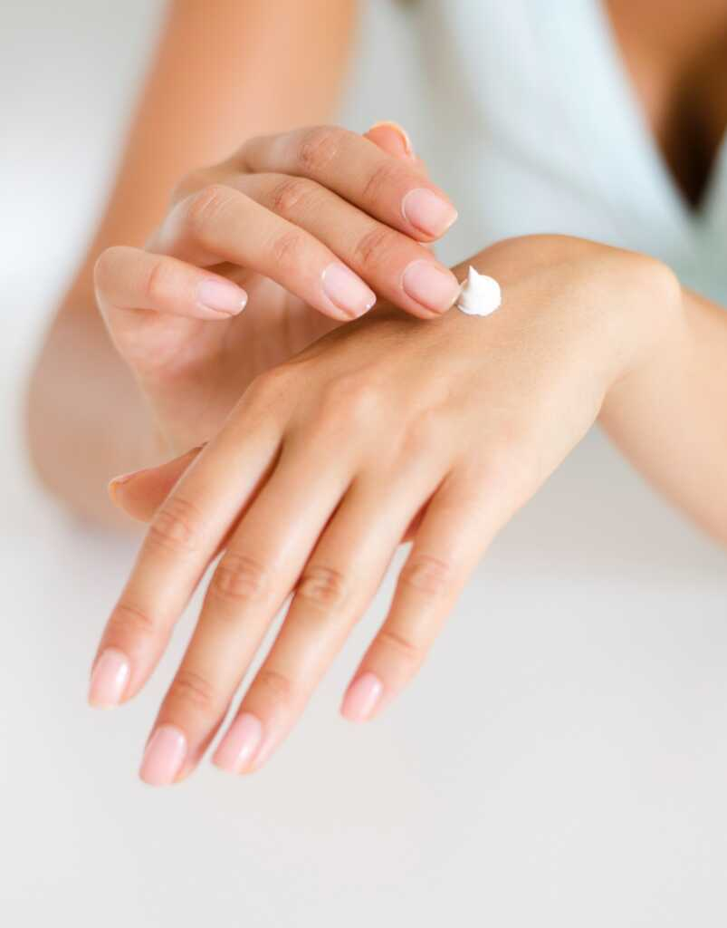 Picture of someone applying cream of hands